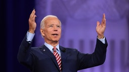 Joe Biden gestures as he speaks during a town hall devoted to LGBTQ issues