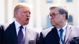 U.S. President Donald Trump, left, speaks to William Barr, U.S. attorney general, during the 38th annual National Peace Officers Memorial Day service at the U.S. Capitol in Washington, D.C., U.S., on Wednesday, May 15, 2019. Trump is poised to delay a decision by up to six months to impose auto tariffs to avoid blowing up negotiations with the EU and Japan and further antagonizing allies as he ramps up his trade war with China, according to people close to the discussions.