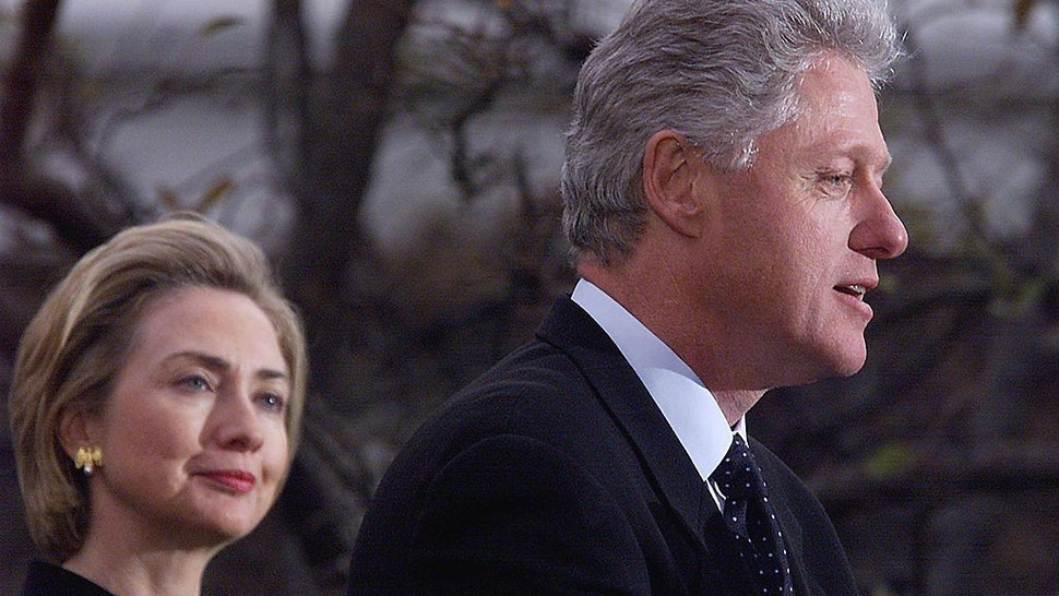 US President Bill Clinton (R) appears with First Lady Hillary Clinton to make a statement to reporters outside the oval office following his impeachment by the US House of Representatives. Clinton rejected calls for his resignation after the House impeached him on one count of perjury and obstruction of justice. AFP PHOTO (ELECTRONIC IMAGE) Tim SLOAN (Photo credit should read TIM SLOAN/AFP via Getty Images)