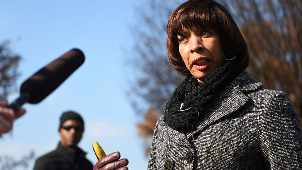 BALTIMORE, MD - DECEMBER 3: Baltimore Mayor Catherine Pugh marches in the Mayor's Annual Christmas parade in Hampden, Baltimore, MD, December 3, 2017. Baltimore recently topped 300 murders and Pugh faces other problems of poverty and drugs.