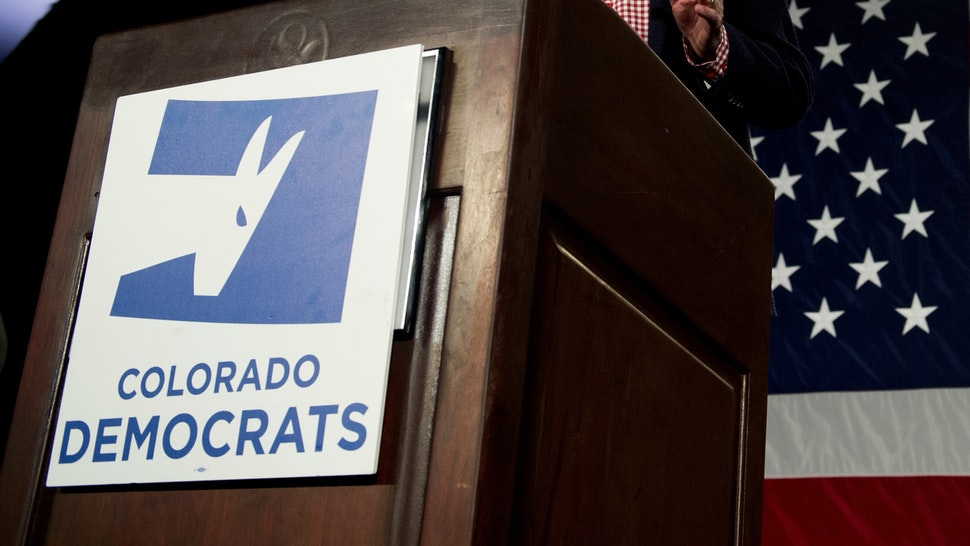 Colorado Governor John Hickenlooper addresses supporters during the Colorado Democrats watch party in Denver, Colorado, on November 6, 2018.