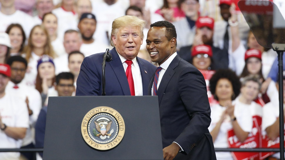 U.S. President Donald Trump, left, appears alongside Daniel Cameron, Republican candidate for Kentucky attorney general, during a rally in Lexington, Kentucky, U.S., on Monday, Nov. 4, 2019. President Trump encouraged his supporters in Kentucky to vote Tuesday to re-elect the states Republican governor, declaring it would send a message to congressional Democrats conducting an impeachment inquiry.