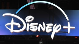 """A Disney+ streaming service sign is pictured at the D23 Expo, billed as the """"largest Disney fan event in the world,"""" on August 23, 2019 at the Anaheim Convention Center in Anaheim, California. - Disney Plus will launch on November 12 and will compete with out streaming services such as Netflix, Amazon, HBO Now and soon Apple TV Plus."""