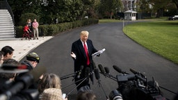 U.S. President Donald Trump speaks to members of the media before boarding Marine One on the South Lawn of the White House in Washington, D.C., U.S., on Wednesday, Nov. 20, 2019. The House Intelligence Committee is hearing from Gordon Sondland, the U.S. ambassador to the European Union, on the fourth day of public testimony in the impeachment inquiry into President Trump. Photographer: Al