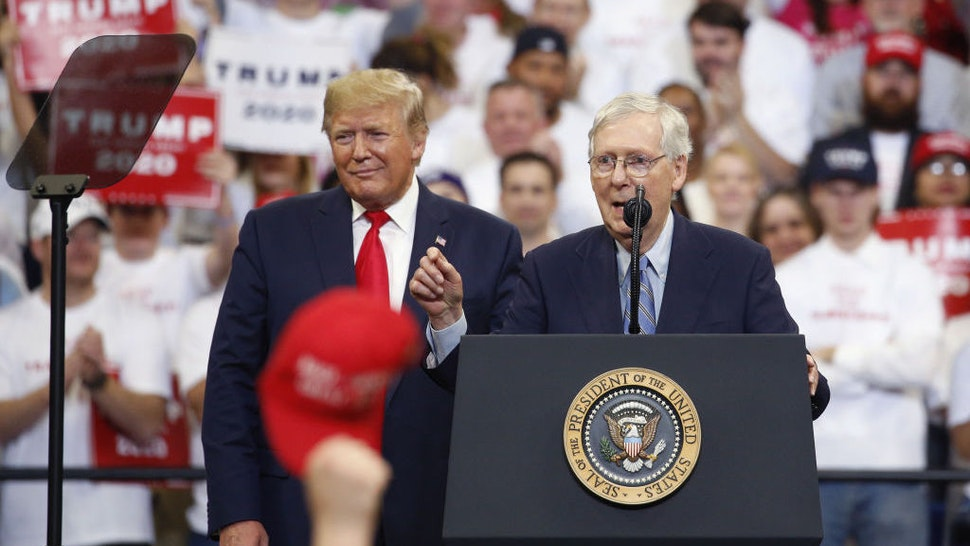 Senate Majority Leader Mitch McConnell, a Republican from Kentucky, right, speaks during a rally with U.S. President Trump in Lexington, Kentucky, U.S., on Monday, Nov. 4, 2019. President Trumpencouraged his supporters in Kentucky to vote Tuesday to re-elect the state's Republican governor, declaring it would send a message to congressional Democrats conducting an impeachment inquiry. Photographer: Luke Sharrett/Bloomberg