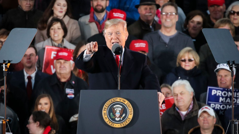 President Donald Trump speaks during a rally at the Tupelo Regional Airport, November 26, 2018 in Tupelo, Mississippi. President Trump is holding two rallies on Monday in Mississippi, in support of Republican candidate for U.S. Senate Cindy Hyde-Smith, who faces off against Democratic candidate Mike Espy in a runoff election on Tuesday. (Photo by Drew Angerer/Getty Images)