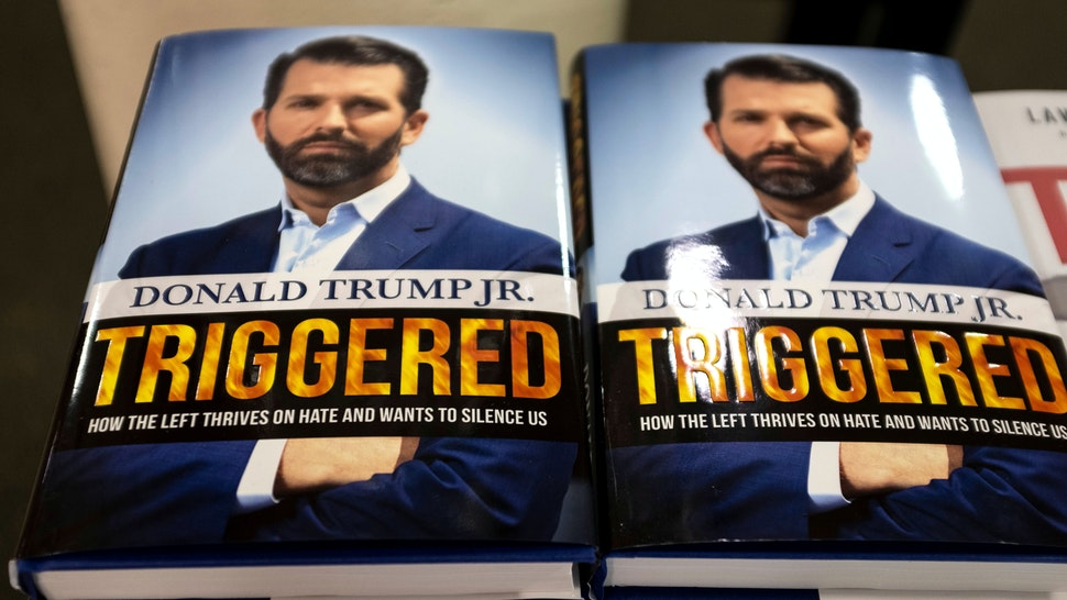 "The book ""Triggered: How the Left Thrives on Hate and Wants to Silence US,"" by Donald Trump Jr. is viewed in a bookstore in Manhattan on November 5, 2019 in New York City. - Donald Trump Jr. released a book Tuesday that rails against the left as he admitted he had caught the political bug and may consider running for office in the future. In ""Triggered: How the Left Thrives on Hate and Wants to Silence US,"" the president's son fiercely defends his father and slams mainstream media and political opponents including Hillary Clinton."