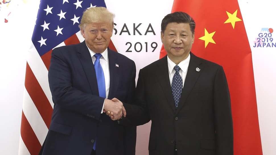 OSAKA, JAPAN - JUNE 29: Chinese President Xi Jinping (R) shakes hands with US President Donald Trump before a bilateral meeting during the G20 Summit on June 29, 2019 in Osaka, Japan.
