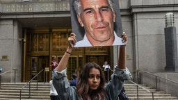 "NEW YORK, NY - JULY 08: A protest group called ""Hot Mess"" hold up signs of Jeffrey Epstein in front of the federal courthouse on July 8, 2019 in New York City. According to reports, Epstein will be charged with one count of sex trafficking of minors and one count of conspiracy to engage in sex trafficking of minors."