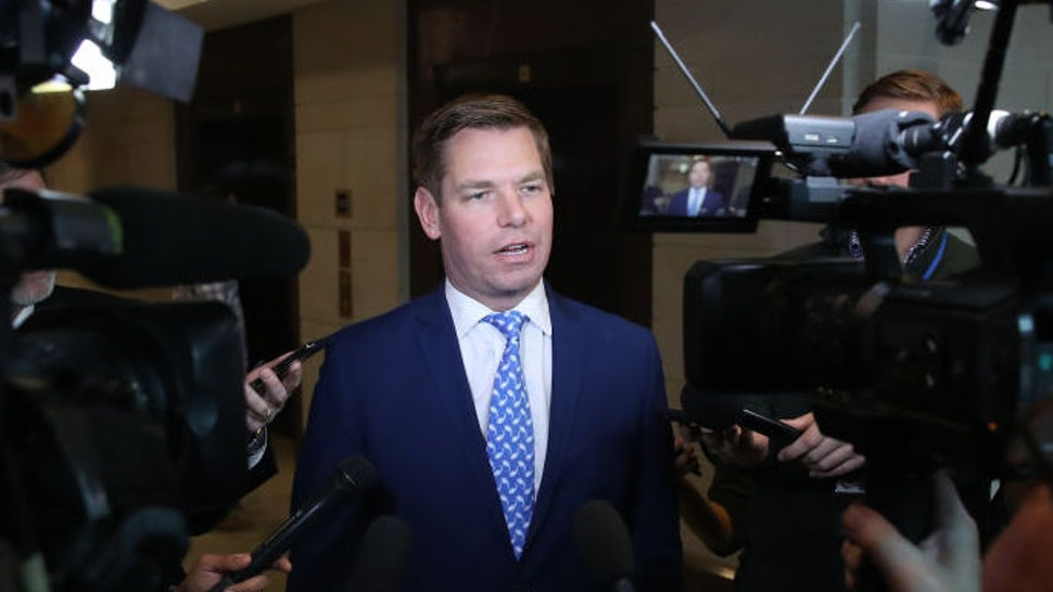 Rep. Eric Swalwell (D-CA), talks to the media outside of a closed-door hearing at the U.S. Capitol on November 7, 2019 in Washington, DC. the Chairman of the House Intelligence Committee, Adam Schiff (D-CA) has announced that public hearings will begin next week in the impeachment inquiry against U.S. President Donald Trump. (Photo by Mark Wilson/Getty Images)