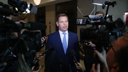 WASHINGTON, DC - NOVEMBER 07: Rep. Eric Swalwell (D-CA), talks to the media outside of a closed-door hearing at the U.S. Capitol on November 7, 2019 in Washington, DC. the Chairman of the House Intelligence Committee, Adam Schiff (D-CA) has announced that public hearings will begin next week in the impeachment inquiry against U.S. President Donald Trump.