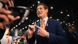 Representative Eric Swalwell, a Democrat from California and 2020 presidential candidate, speaks to the media following the Democratic presidential candidate debate in Miami, Florida, U.S., on Thursday, June 27, 2019. The candidates running for the Democratic presidential nomination rallied around the idea of a government-run Medicare option Thursday night, disagreeing only over whether to make it an option or put all Americans in the program.