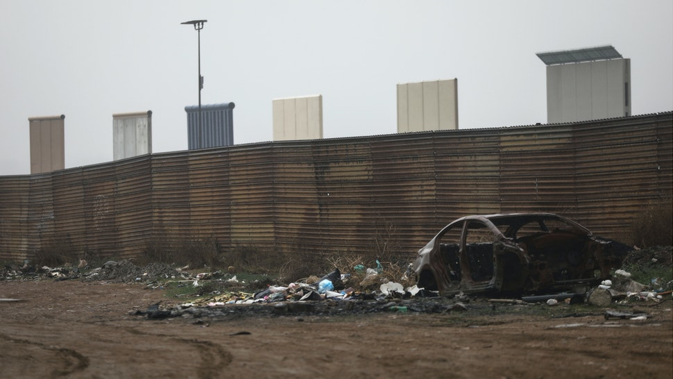 U.S. President Donald Trump's border wall prototypes (TOP) stand as seen from the Mexico side of the US/ Mexico border on March 10, 2018 in Tijuana, Mexico.