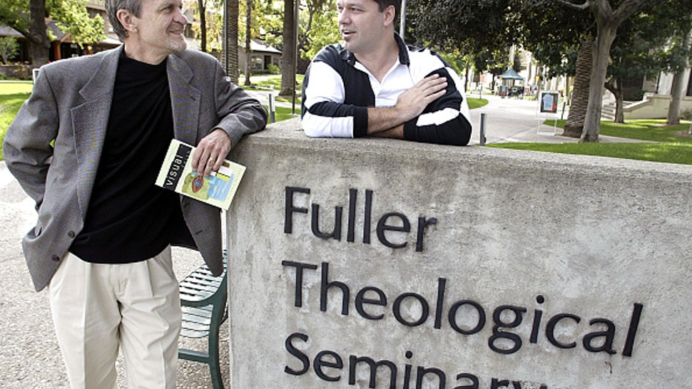 William Dyrness, professor of theology and culture at Fuller Theological Seminary and, mime artist Todd Farley in front of the campus in Pasadena Thursday. Increasingly, churches are integrating all types of art – from visual to dramatic performances, such as mime, in worship.
