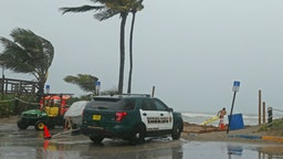 A Broward Sheriff's Office vehicle at the Dania Beach Pier in Dania Beach, Fla., as Tropical Storm Gordon passes by South Florida with wind gusts and heavy rainfall for the Labor Day holiday on Monday, Sept. 3, 2018.