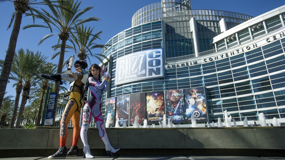 Yayin Chan, dressed as Tracer from the video game Overwathc, left, and Chun Tin Kuo, dressed as D.Va, posed for pictures during Blizzcon in Anaheim, California, November 4, 2016. Blizzcon is the annual gaming convention for Blizzard Entertainment, based in Irvine. (Photo by Jeff Gritchen/Digital First Media/Orange County Register via Getty Images)