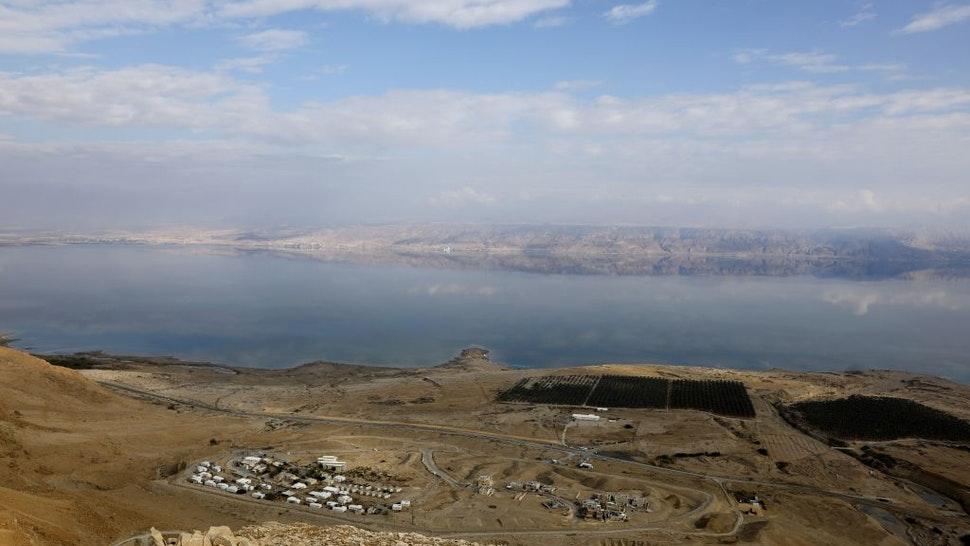 A picture taken on November 24, 2018 shows part of the Dead Sea backdropped by mountains in Jordan as seen from the Judean Desert in the West Bank.