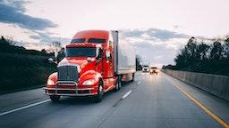 18 wheeler semi-truck on the highway at night - stock photo