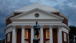 A statue of Thomas Jefferson stands in front of the Rotunda at the University of Virginia, Friday June 10, 2016.