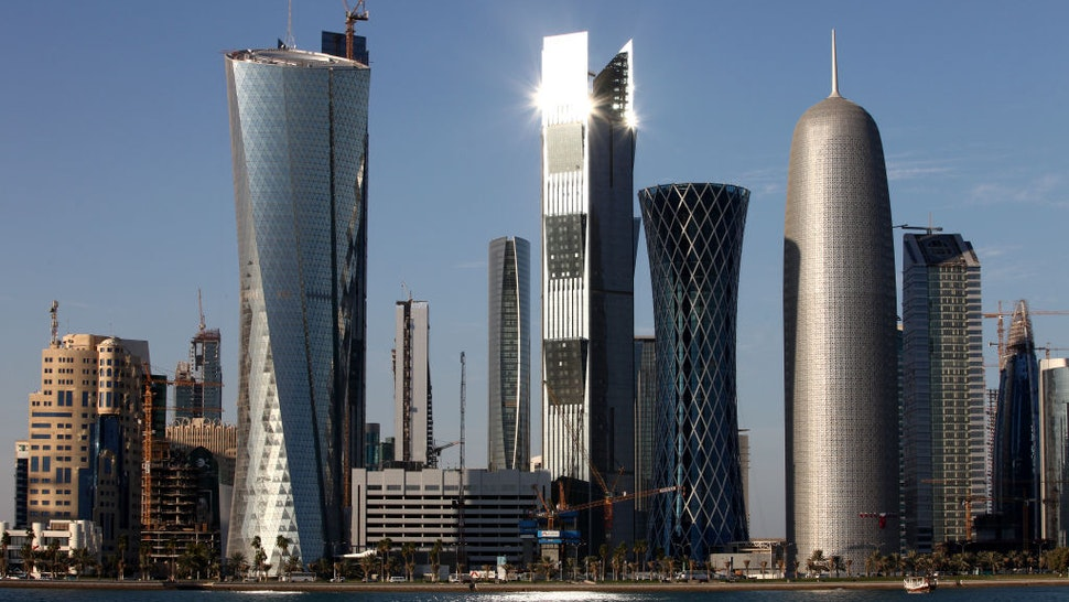 DOHA, QATAR - DECEMBER 30: New high-rise office buildings and hotels, some of them still under construction, stand in the West Bay and Oneiza district near City Center mall and build the skyline at the opposite of the promenade at the Al Corniche road on December 30, 2010 in Doha, Qatar. The International Monetary Fund (IMF) recently reiterated its projection for the Qatari economy with predictions of double digit growth for 2010 and 2011. Though natural gas and petroleum production are still the biggest two single sources of income, the non-energy sector overtook oil and gas in Qatari GDP for 2009. The FIFA world cup 2022 will takes place in Qatar.