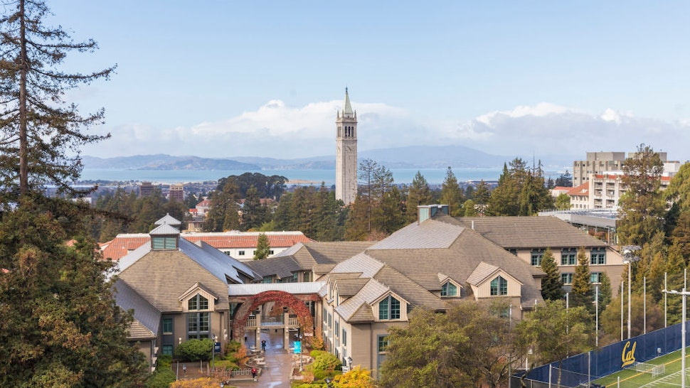 BERKELEY, CA - DECEMBER 1: A general view of the University of California Berkeley campus including Sather Tower, also known as The Campanile, as seen from Memorial Stadium before the 121st Big Game played between the California Golden Bears and the Stanford Cardinal football teams on December 1, 2018 at the University of California in Berkeley, California. The Haas School of Business is visible in foreground (with gabled roofs), San Francisco Bay in the background.