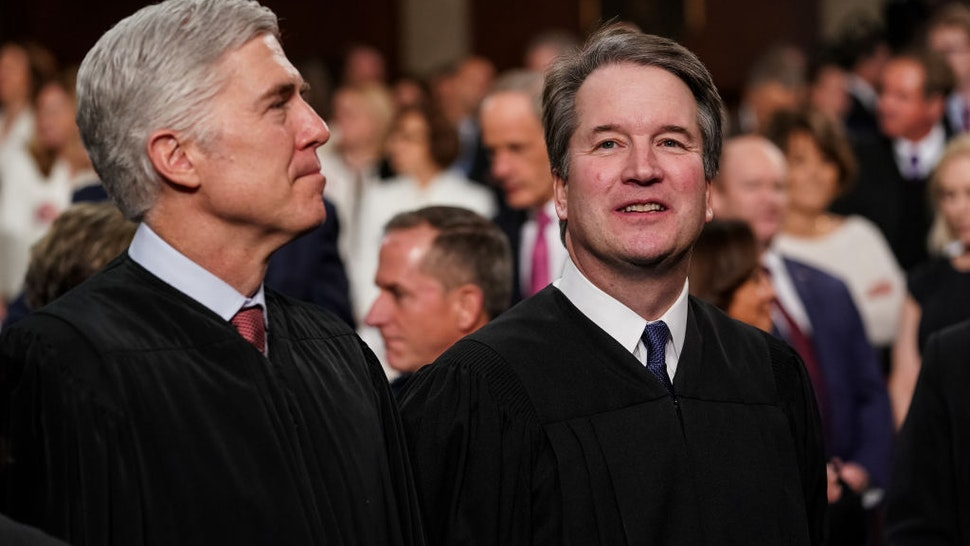Neil Gorsuch, associate justice of the U.S. Supreme Court, left, and Brett Kavanaugh, associate justice of the U.S. Supreme Court, attend the U.S. President Donald Trump's State of the Union address to a joint session of Congress at the U.S. Capitol in Washington, D.C., U.S., on Tuesday, Feb. 5, 2019. Trump cast his fight against illegal migration to the U.S. as a moral struggle, and charged in his second State of the Union address that partisan investigations threaten economic progress under his administration.