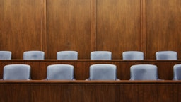 Empty chairs in jury box - stock photo