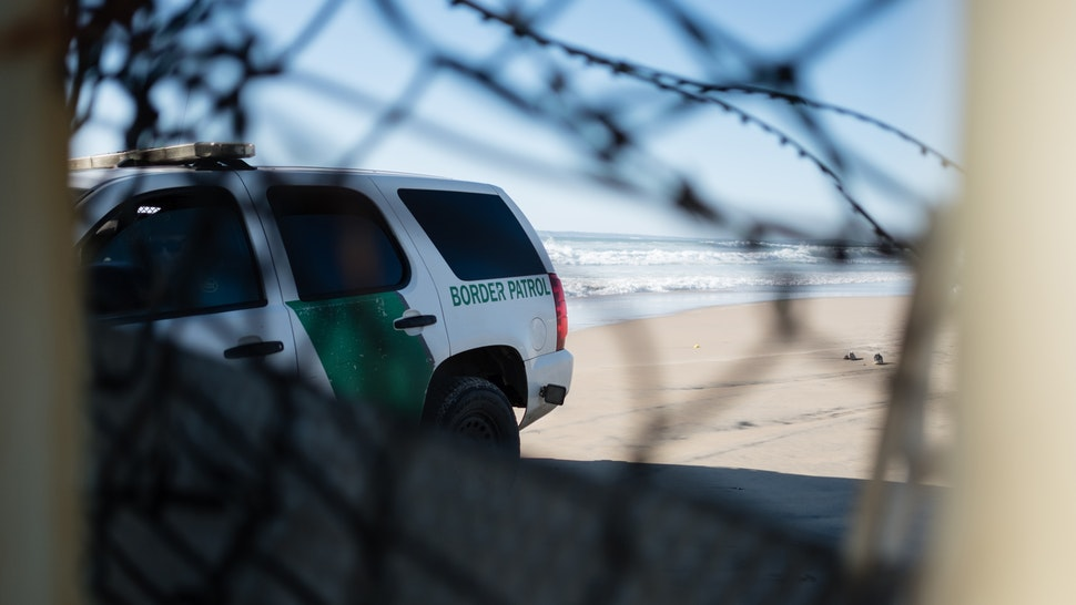 TIJUANA, BAJA CALIFORNIA, MEXICO - 2019/03/13: United States Border Patrol is seen blocking the wall at the US-Mexico border after a large group cut through the wall , fleeing to United States. In February 2019, around 76,000 fled from the southern border into the United states in order to find a better live. (Photo by Megan Jelinger/SOPA Images/LightRocket via Getty Images)