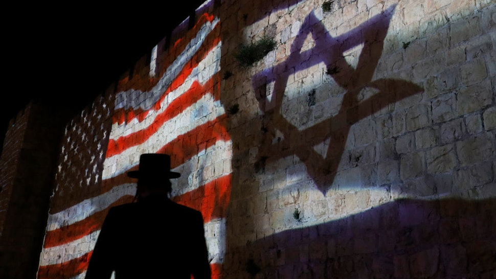 The Israeli and United States flags are projected on the walls of the ramparts of Jerusalem's Old City, to mark one year since the transfer of the US Embassy from Tel Aviv to Jerusalem on May 15, 2019.