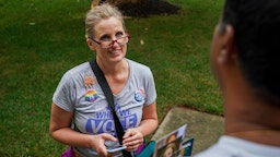 Juli Briskman, the Democratic nominee for Supervisor of Loudoun County's Algonkian District, chats with Hari Moosani as she campaigns door-to-door in her neighborhood on Wednesday, July 17, 2019, in Sterling, VA.