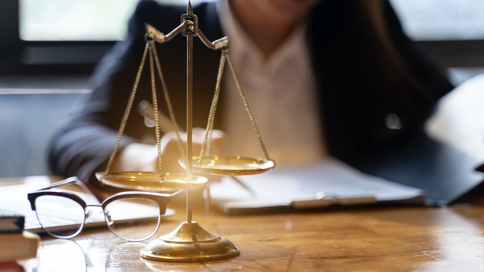 Midsection Of Lawyer Working At Desk In Courtroom - stock photo