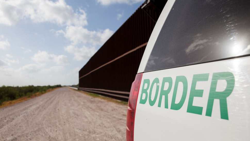 UNITED STATES - AUGUST 20: A Customs and Border Protection vehicle patrols the border wall in Rio Grande Valley sector of the Texas border on Aug. 20, 2019.