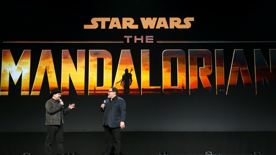 ANAHEIM, CALIFORNIA - AUGUST 23: Executive producer/writers Dave Filoni and Jon Favreau of 'The Mandalorian' took part today in the Disney+ Showcase at Disney's D23 EXPO 2019 in Anaheim, Calif. 'The Mandalorian' will stream exclusively on Disney+, which launches November 12. (Photo by Jesse Grant/Getty Images for Disney)