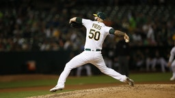 Mike Fiers #50 of the Oakland Athletics pitches during the game against the New York Yankees at the Oakland-Alameda County Coliseum on August 21, 2019 in Oakland, California.