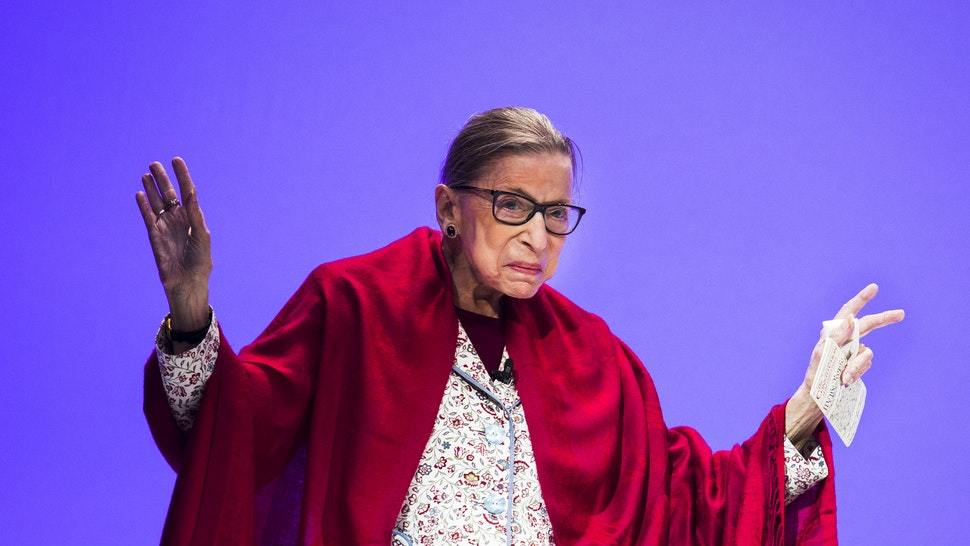 U.S. Supreme Court Justice Ruth Bader Ginsburg walks on the stage to join Amherst College President Biddy Martin for a conversation in Coolidge Cage at Amherst College in Amherst, MA on Oct. 3, 2019. Hundreds of Amherst students and faculty members listened to the Justice speak on biases, women's equality and her time spent attending Cornell University.