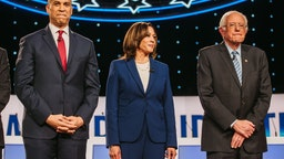 2020 Democratic presidential candidates Senator Cory Booker, a Democrat from New Jersey, from left, Senator Kamala Harris, a Democrat from California, and Senator Bernie Sanders, an independent from Vermont, arrive on stage for the Democratic presidential candidate debate in Westerville, Ohio, U.S., on Tuesday, Oct. 15, 2019.
