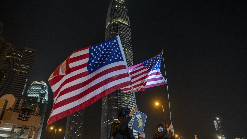 Protesters are seen waving US Flags during an anti-government Protest in Hong Kong, China, October 19, 2019. Pro-democracy Protesters have been taking to the streets in Hong Kong for months of the Government. (Photo by Vernon Yuen/NurPhoto via Getty Images)