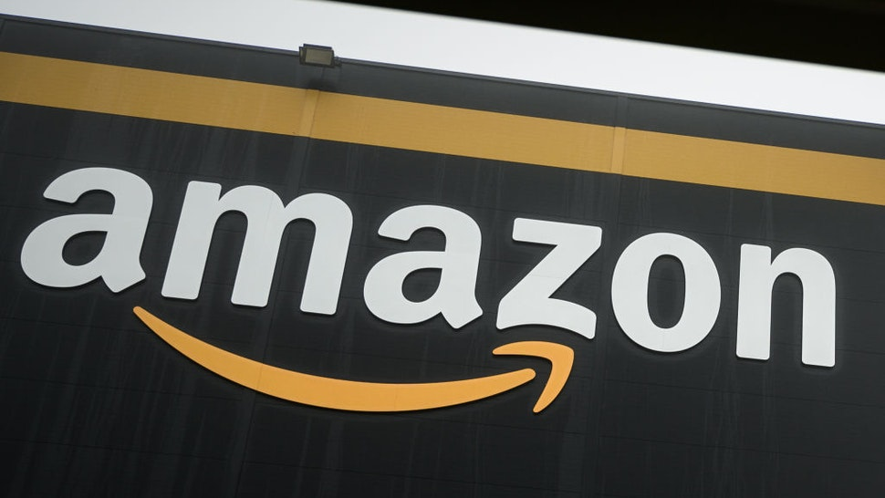 This picture taken on on October 22, 2019, shows the logo of Amazon on a new warehouse, part of mobile robotic fulfilment systems also known as 'Amazon robotics', in Bretigny-sur-Orge, some 30kms south of Paris.