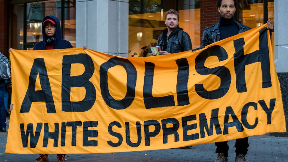 Protesters holding an ABOLISH WHITE SUPREMACY banner at the rally in Metrotech Plaza.