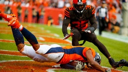 Wide receiver Courtland Sutton #14 of the Denver Broncos catches a touchdown pass as safety Jermaine Whitehead #35 of the Cleveland Browns defends on the play during the first quarter at Broncos Stadium at Mile High on November 3, 2019 in Denver, Colorado.