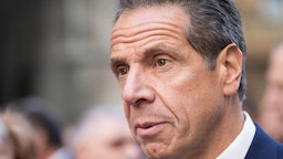 New York State Governor Andrew Cuomo talks to reporters during the Columbus Day Parade.