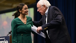 DES MOINES, IA - NOVEMBER 09: U.S. Rep. Alexandria Ocasio-Cortez (D-NY) is joined on stage by Democratic Presidential candidate Bernie Sanders (I-VT) during the Climate Crisis Summit at Drake University on November 9, 2019 in Des Moines, Iowa. Sanders, Ocasio-Cortez, and author Naomi Klein spoke about the current state of climate change in relation to U.S. policy. (Photo by Stephen Maturen/Getty Images)