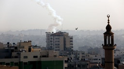 A Palestinian rocket is pictured in the air after being fired from Gaza city on November 13, 2019. - Israel's military killed a commander from Palestinian militant group Islamic Jihad in a strike on his home in the Gaza Strip, triggering exchanges of fire in a violent escalation that left another nine Gazans dead.