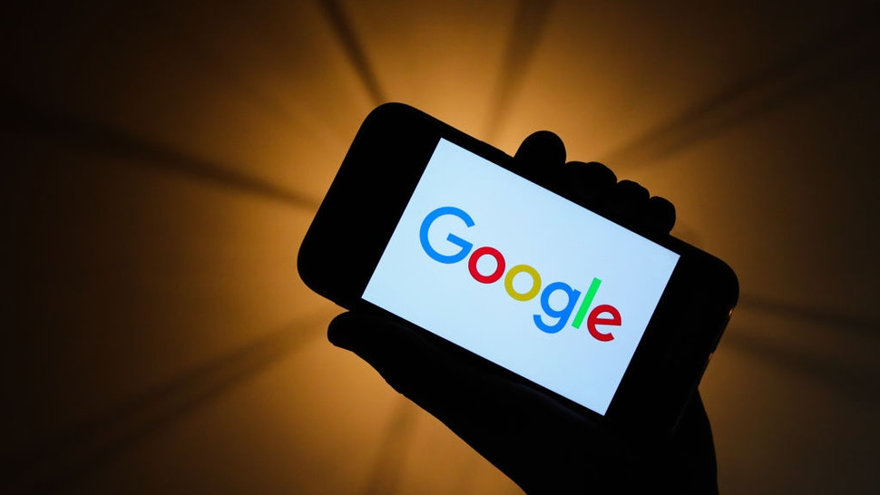 Google logo is seen displayed on a phone screen in this illustration photo taken in Krakow, Poland on November 13, 2019.
