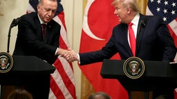 WASHINGTON, DC - NOVEMBER 13: U.S. President Donald Trump and Turkish President Recep Tayyip Erdogan shakes hands during a press conference in the East Room of the White House on November 13, 2019 in Washington, DC. During their meeting, Trump and Erdogan were scheduled to discuss Turkey's purchase of a Russian air defense system as well as the Turkish offensive against the Kurds in Syria. (Photo by Mark Wilson/Getty Images)