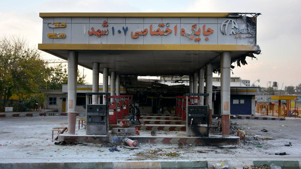 """A picture taken on November 17, 2019 shows a scorched gas station that was set ablaze by protesters during a demonstration against a rise in gasoline prices in Eslamshahr, near the Iranian capital of Tehran. - President Hassan Rouhani warned that riot-hit Iran could not allow """"insecurity"""" after two days of unrest killed two people and saw authorities arrest dozens and restrict internet access. Rouhani defended the controversial petrol price hike that triggered the protests -- a project which the government says will finance social welfare spending amid a sharp economic downturn (Photo by - / AFP) (Photo by -/AFP via Getty Images)"""