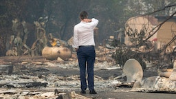 Gov. Gavin Newsom surveys a home destroyed in the Kincade Fire, Friday, Oct. 25, 2019, in Geyserville, Calif.