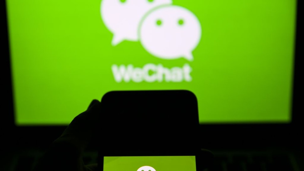 """The logo of """"WeChat"""", messaging and social media app, is seen on a screen of a smartphone in Ankara, Turkey on November 28, 2019."""