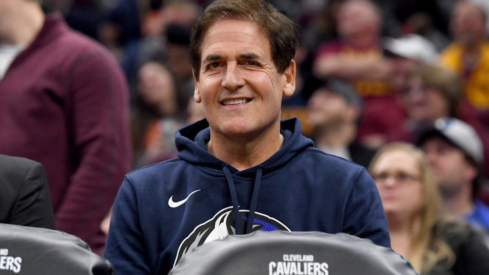 Mark Cuban owner of the Dallas Mavericks watches his team from the bench during the first half against the Cleveland Cavaliers at Rocket Mortgage Fieldhouse on November 03, 2019 in Cleveland, Ohio. NOTE TO USER: User expressly acknowledges and agrees that, by downloading and/or using this photograph, user is consenting to the terms and conditions of the Getty Images License Agreement.
