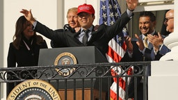 U.S. President Donald Trump reacts to Washington National catcher Kurt Suzuki wearing a 'Make America Great Again' cap during a celebration of the 2019 World Series Champions at the White House November 04, 2019 in Washington, DC. The Nationals are Washington's first Major League Baseball team to win the World Series since 1924.
